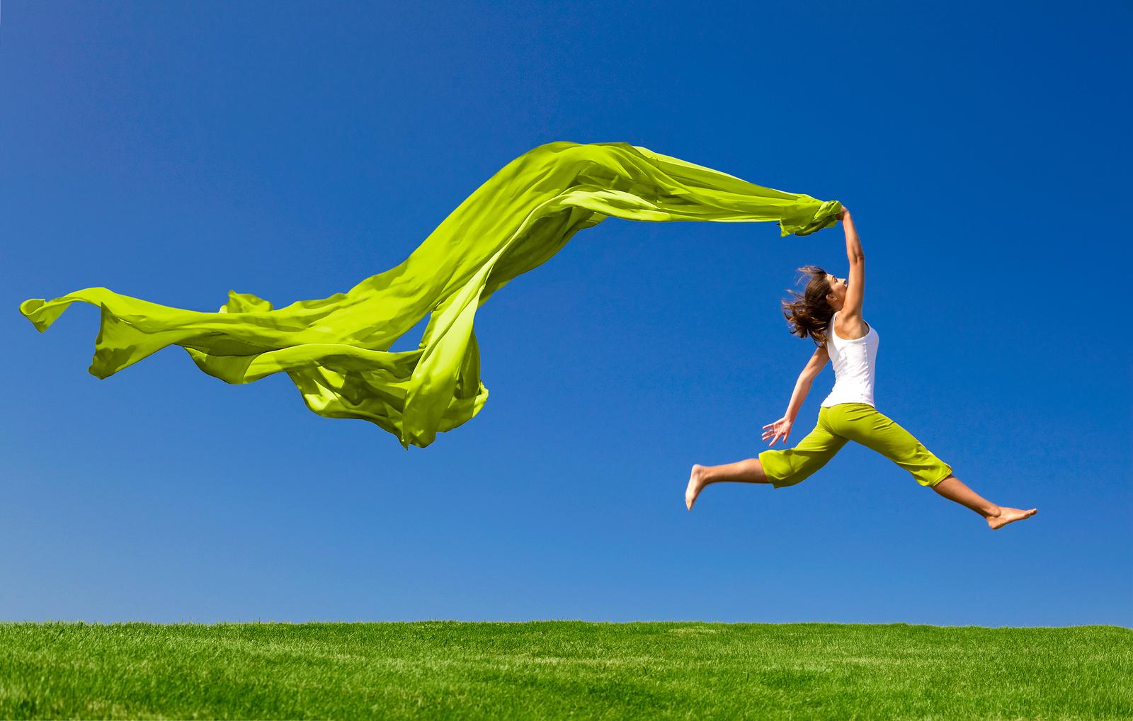 Women Jumping in Sunny Grass
